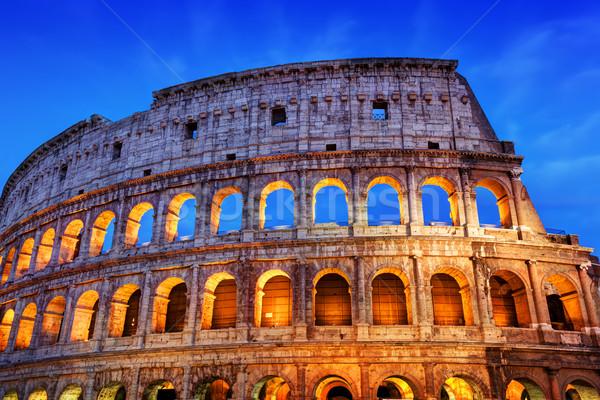 Coliseo Roma Italia iluminado noche símbolo Foto stock © photocreo