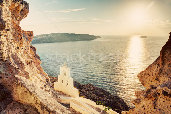 Cliff, volcanic rocks and a traditional chapel on Santorini island, Greece Stock photo © photocreo