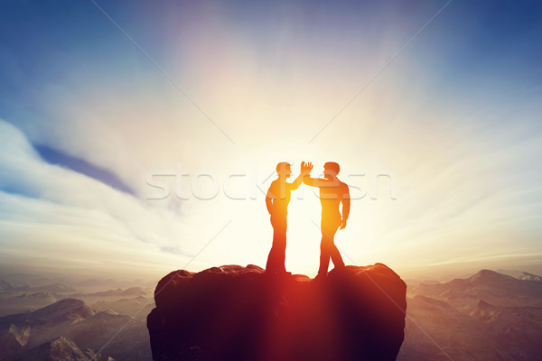 Two men, friends high five on top of the mountains. Agreement Stock photo © photocreo