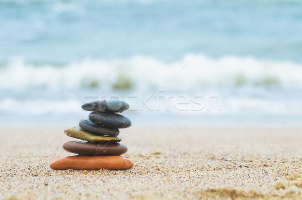 Stack of beach stones on sand Stock photo © photocreo