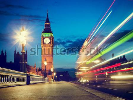 London, the UK. Red bus in motion and Big Ben at night Stock photo © photocreo