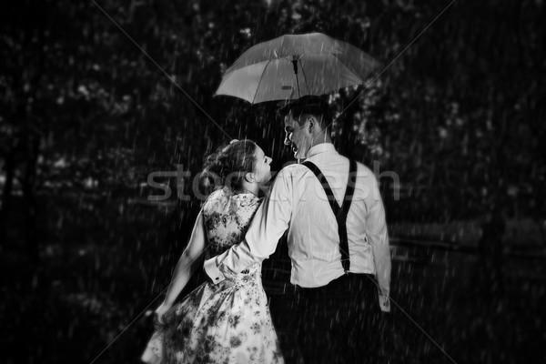 Jovem romântico casal amor chuva Foto stock © photocreo