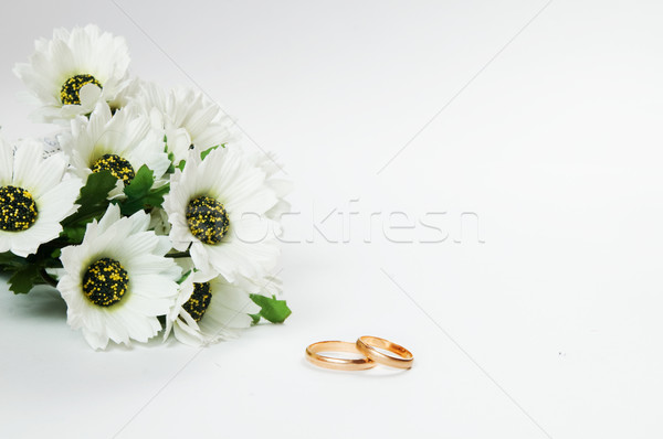 Wedding rings and flowers Stock photo © photocreo