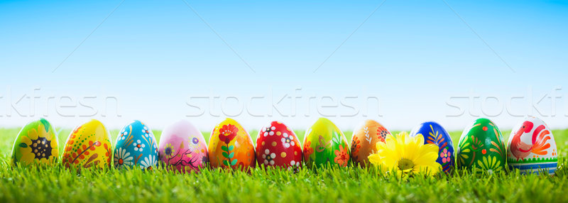 Colorful hand painted Easter eggs on grass. Banner, panoramic  Stock photo © photocreo