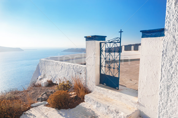 Gate to a church in Fira on Santorini island, Greece. Aegean sea view Stock photo © photocreo