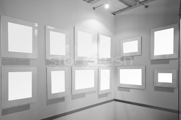 Blank picture frames in art gallery Stock photo © photocreo