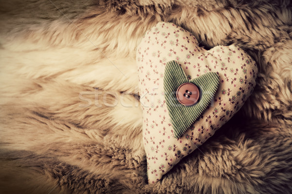 Vintage handmade plush heart on the soft blanket. Romantic love Stock photo © photocreo