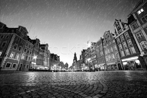 Cobblestone historic old town in rain at night. Wroclaw, Poland. Black and white Stock photo © photocreo