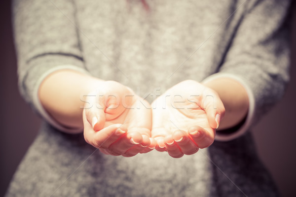 Light in young woman's hands. Sharing, giving, offering, taking care, protection.  Stock photo © photocreo
