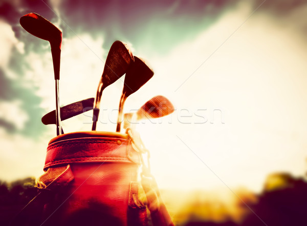 Golf clubs in a leather baggage in vintage, retro style at sunset Stock photo © photocreo