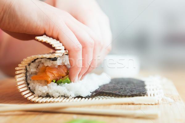 Szusi lazac avokádó rizs evőpálcikák fa asztal Stock fotó © photocreo