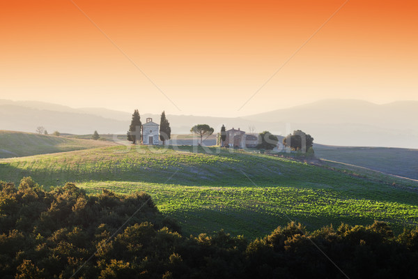 Tuscany landscape at sunrise with a little chapel of Madonna di Vitaleta, Italy. Stock photo © photocreo