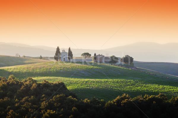 Toscane landschap zonsopgang weinig kapel Italië Stockfoto © photocreo