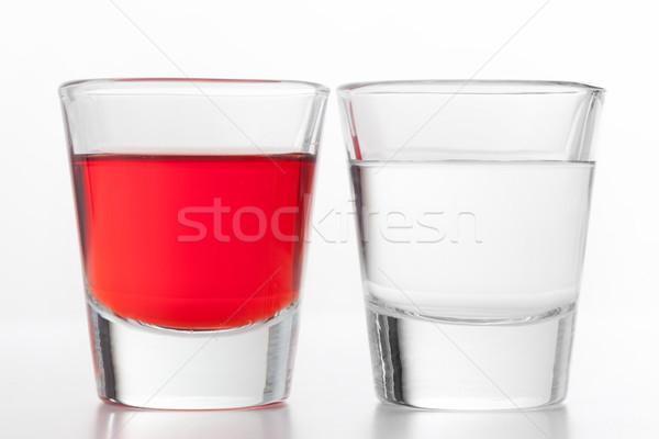 Twee bril alcohol een Rood ander Stockfoto © photocreo