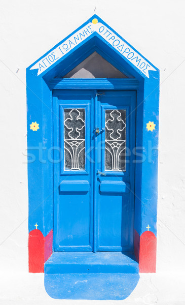 Grunge old blue doors in Oia town, Santorini, Greece. Stock photo © photocreo