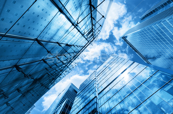 Modern business skyscrapers, high-rise buildings, architecture raising to the sky, sun Stock photo © photocreo