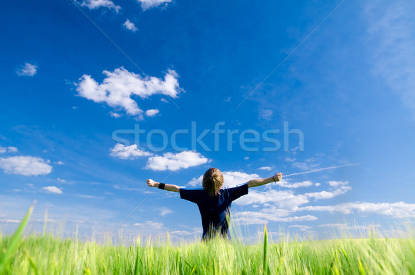 Stock photo: Happy man with arms up