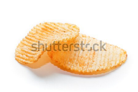 Two spiced potato chips on white background Stock photo © photocreo