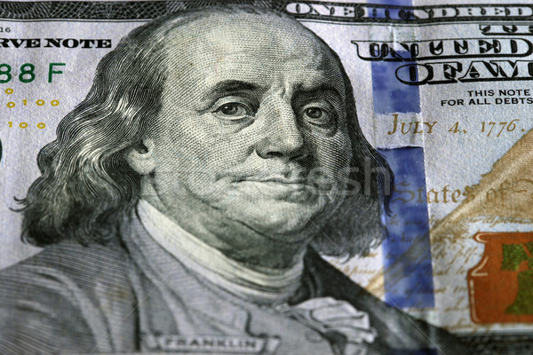 One Hundred Dollars. Selective focus on Benjamin Franklin eyes. Stock photo © photocreo