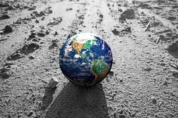 The Earth globe on rocky Mars like surface Stock photo © photocreo