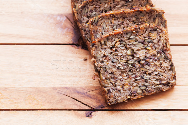 Stock photo: Wholemeal, wholewheat bread on wooden table. Organic, healthy food