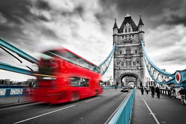 Red bus in motion on Tower Bridge in London, the UK Stock photo © photocreo