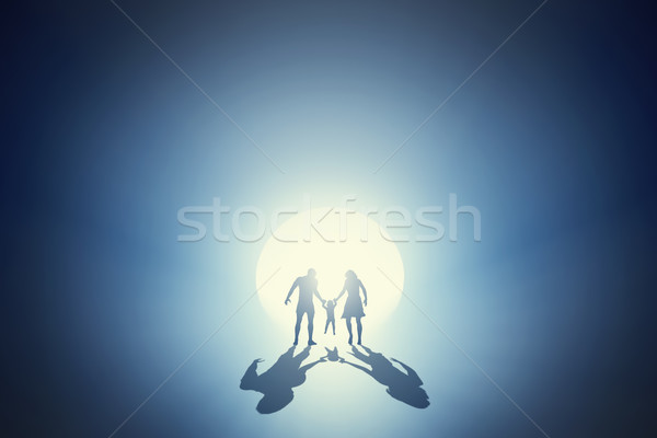 Family going towards light out of deep tunnel. Concept Stock photo © photocreo