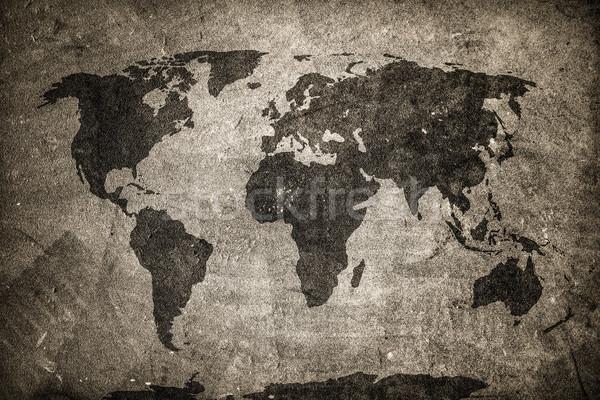 Retro world map on concrete, plaster wall. Vintage, grunge backg Stock photo © photocreo