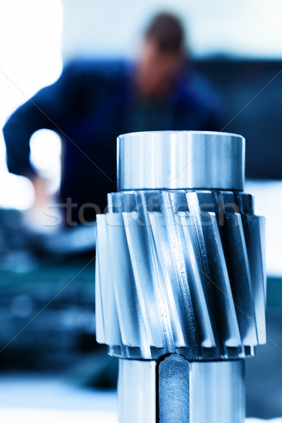 Big industrial element, screw. Man working on machine. Stock photo © photocreo