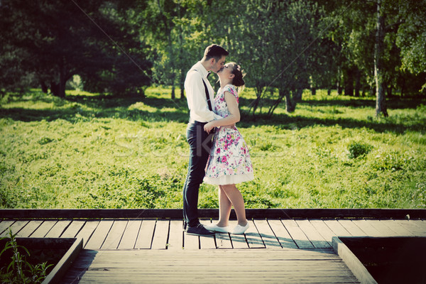 Young couple in love standing on wooden cross-roads Stock photo © photocreo