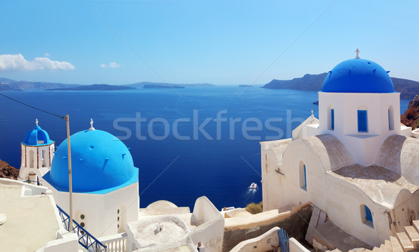Oia town on Santorini island, Greece. Caldera on Aegean sea. Stock photo © photocreo