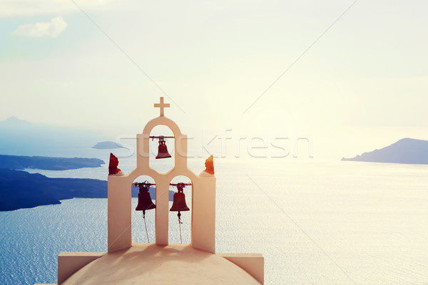 Traditional bells and cross over Aegean sea. Santorini Greece Stock photo © photocreo