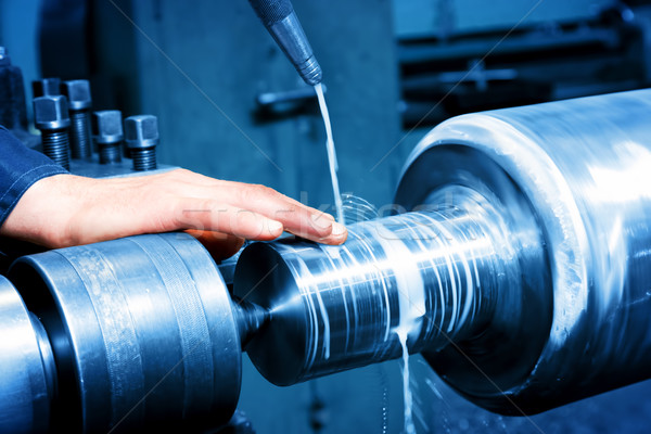 Worker measuring on industrial turning machine. Industry Stock photo © photocreo