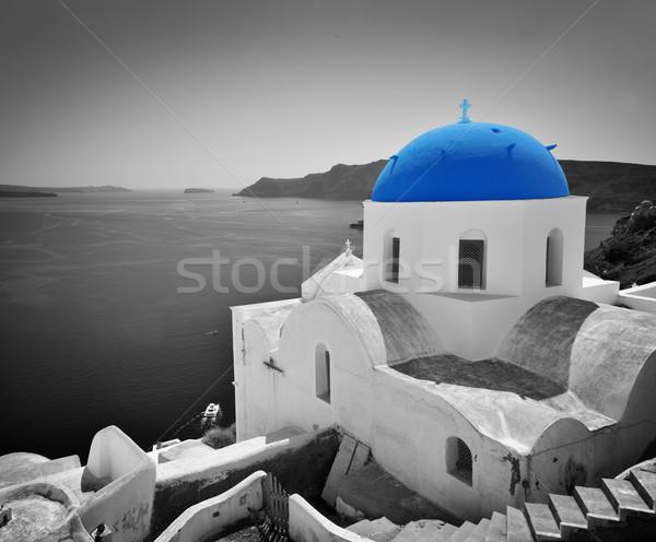 Oia town on Santorini island, Greece. Blue dome church, black and white. Stock photo © photocreo