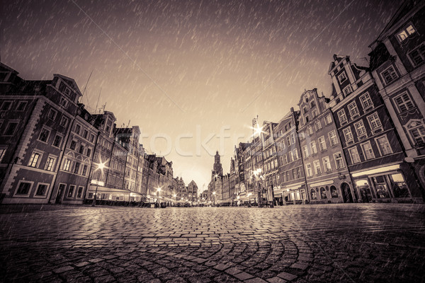 Cobblestone historic old town in rain at night. Wroclaw, Poland. Vintage Stock photo © photocreo