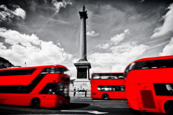 Red buses in motion on Trafalgar Square in London, UK. Nelson's column Stock photo © photocreo