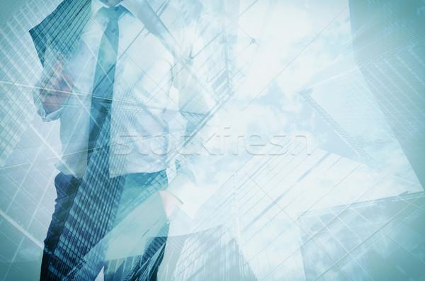 Dupla kitettség üzletember modern felhőkarcolók üzlet Stock fotó © photocreo
