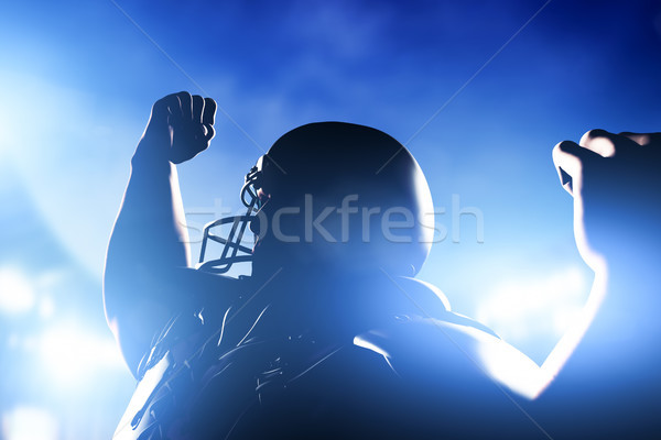 American football player celebrating score and victory. Stock photo © photocreo