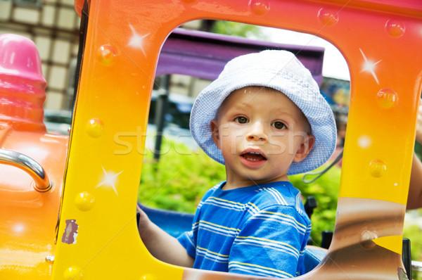 Happy child in funfair Stock photo © photocreo