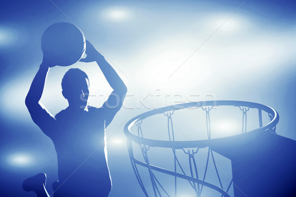 Basketball player silhouette jumping and making slam dunk Stock photo © photocreo