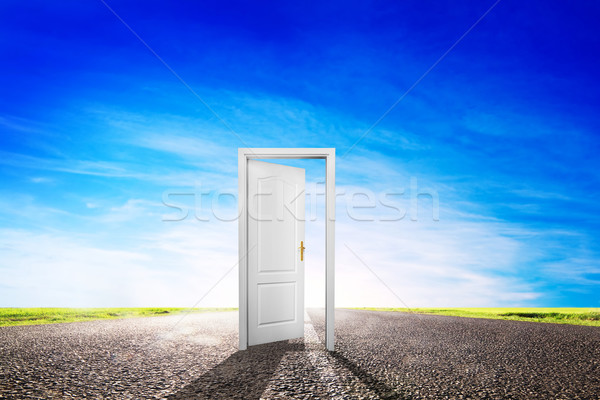 Open door on long empty asphalt road towards sun.  Stock photo © photocreo