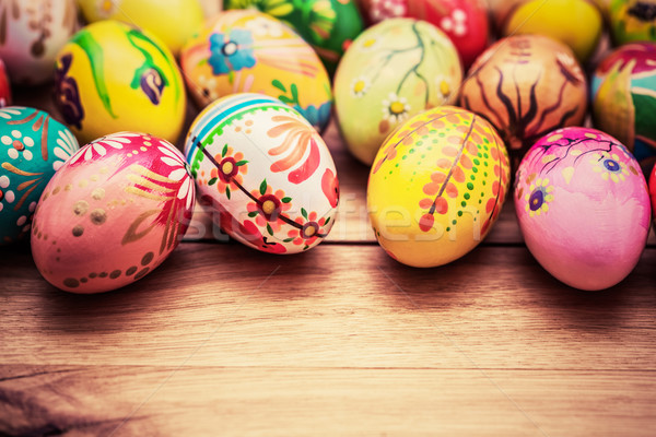 Colorful hand painted Easter eggs on wood. Unique handmade, vint Stock photo © photocreo