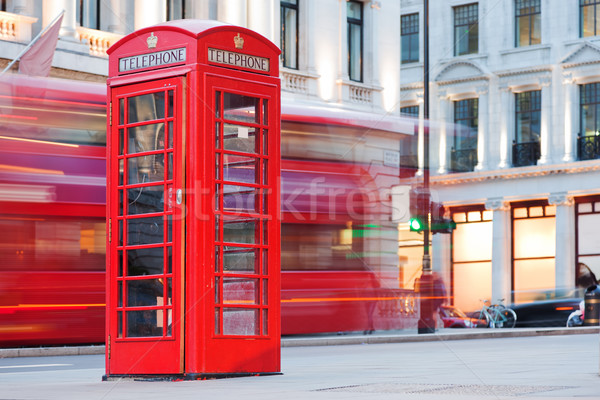 London, UK. Red telephone booth and red bus passing. Symbols of England. Stock photo © photocreo