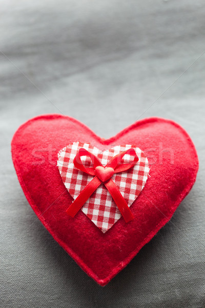 Handmade plush red heart on the soft pillow. Romantic love Stock photo © photocreo