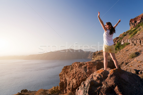 Boldog nő kő kezek magasban Santorini sziget Stock fotó © photocreo