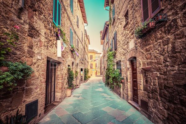 Narrow street in an old Italian town of Pienza. Tuscany, Italy. Vintage Stock photo © photocreo