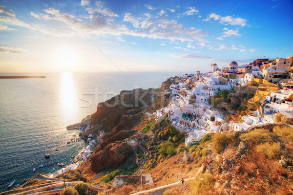 Oia town on Santorini island, Greece at sunset. Famous windmill Stock photo © photocreo