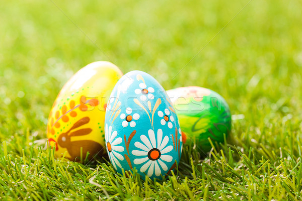 Colorful hand painted Easter eggs in grass. Spring theme Stock photo © photocreo