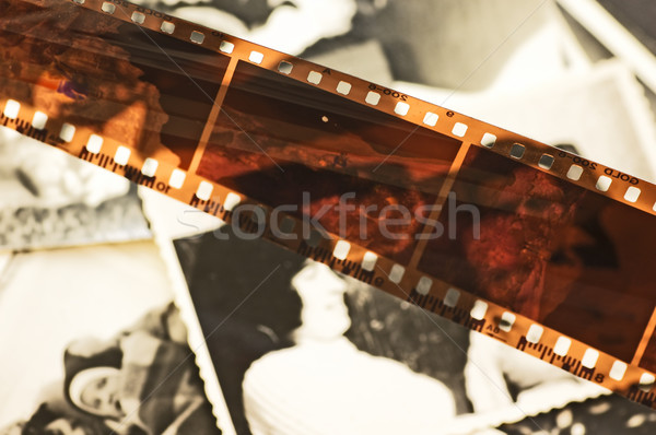 Stock photo: Old film strip and photos background