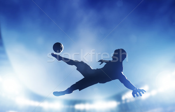 Football, soccer match. A player shooting on goal Stock photo © photocreo